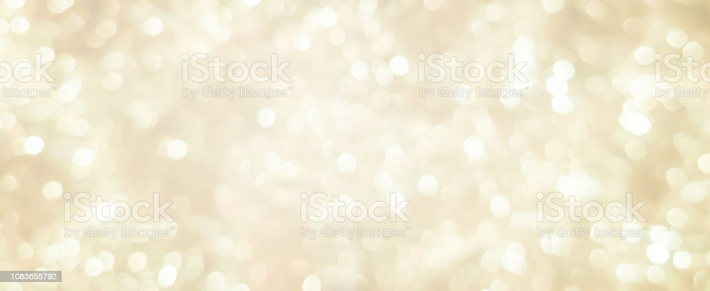 abstract blurred soft bright cream color panoramic background with glowing light and bokeh light effect for merry christmas and happy new year 2019 festival design and element  concept royalty-free stock photo