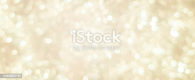 abstract blurred soft bright cream color panoramic background with glowing light and bokeh light effect for merry christmas and happy new year 2019 festival design and element  concept