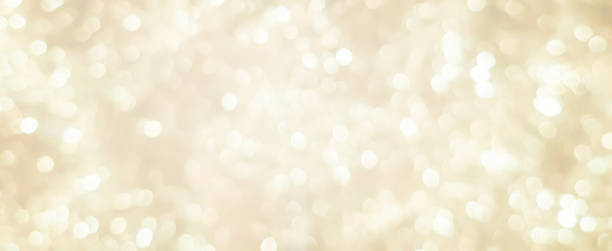 abstract blurred soft bright cream color panoramic background with glowing light and bokeh light effect for merry christmas and happy new year 2019 festival design and element  concept abstract blurred soft bright cream color panoramic background with glowing light and bokeh light effect for merry christmas and happy new year 2019 festival design and element  concept holidays stock pictures, royalty-free photos & images