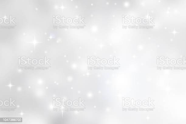 Photo of Abstract blurred soft white and gray silver beautiful glowing blinking bokeh and snowfall and star on colorful background for merry christmas and happy new year design banner  and presentation concept