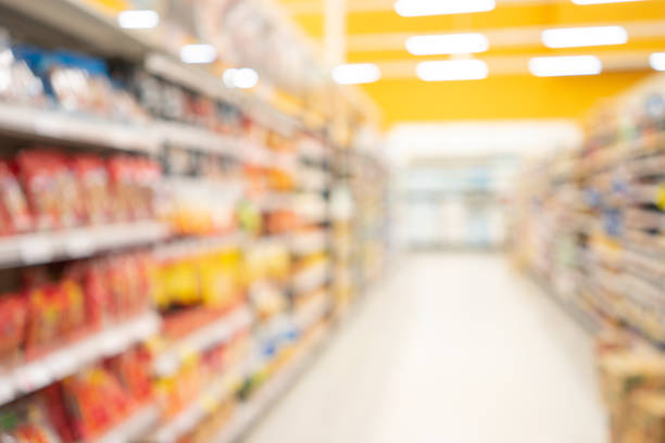 Abstract blurred supermarket view of empty supermarket aisle, defocused blurry background with bokeh light in store. Business concept. Abstract blurred supermarket view of empty supermarket aisle, defocused blurry background with bokeh light in store. Business concept. supermarket stock pictures, royalty-free photos & images