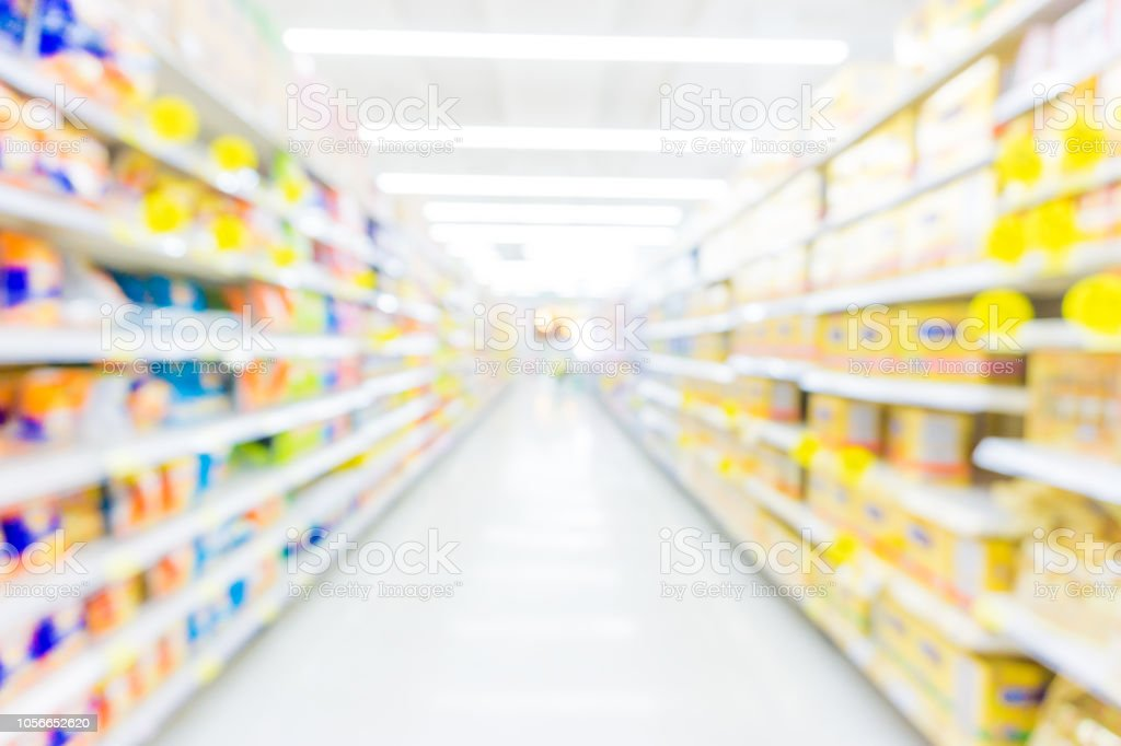 Abstract blurred supermarket with many food and goods on shelf,...