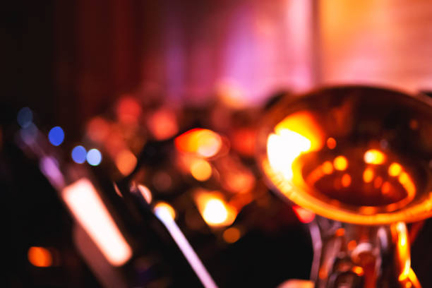 abstract blurred symphony orchestra background - orchestra foto e immagini stock