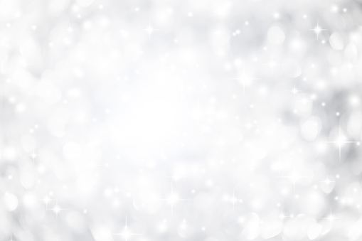 istock abstract blurred white and silver gradient color background with  glowing and snowfall and blink star effect for merry christmas and happy new year festival design and element  concept 1066912686