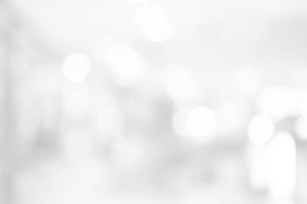 abstract blurred white color background with bokeh light for design concept - bianco foto e immagini stock