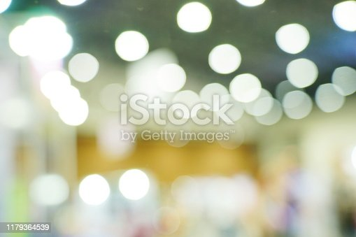 istock Abstract blurred white color background with bokeh light 1179364539