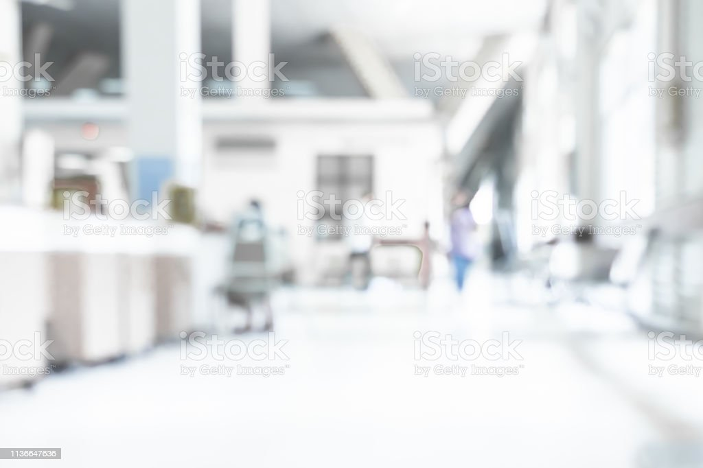 Abstract blurred white doctor medical office room background concept...