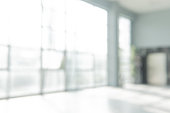 istock Abstract blurred white doctor medical office room background concept for blur empty space grey modern hospital clinic pharmacy, light clean interior retail sale, blue glare window hallway building 1179462556