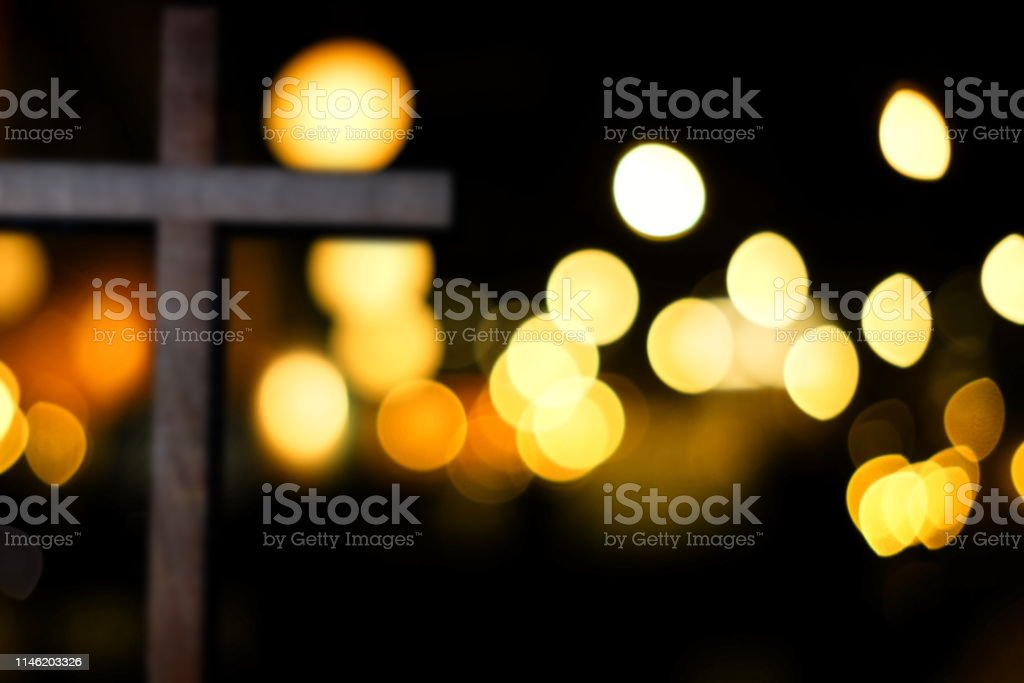 Abstract Blurred Wooden Crucifix of Jesus with Bokeh Background for...