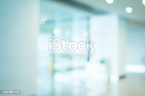 abstract blurred workplace interior with modern glass window reflective background ; loft style contemporary design of lounge or lobby for presentation and design as banner and ads