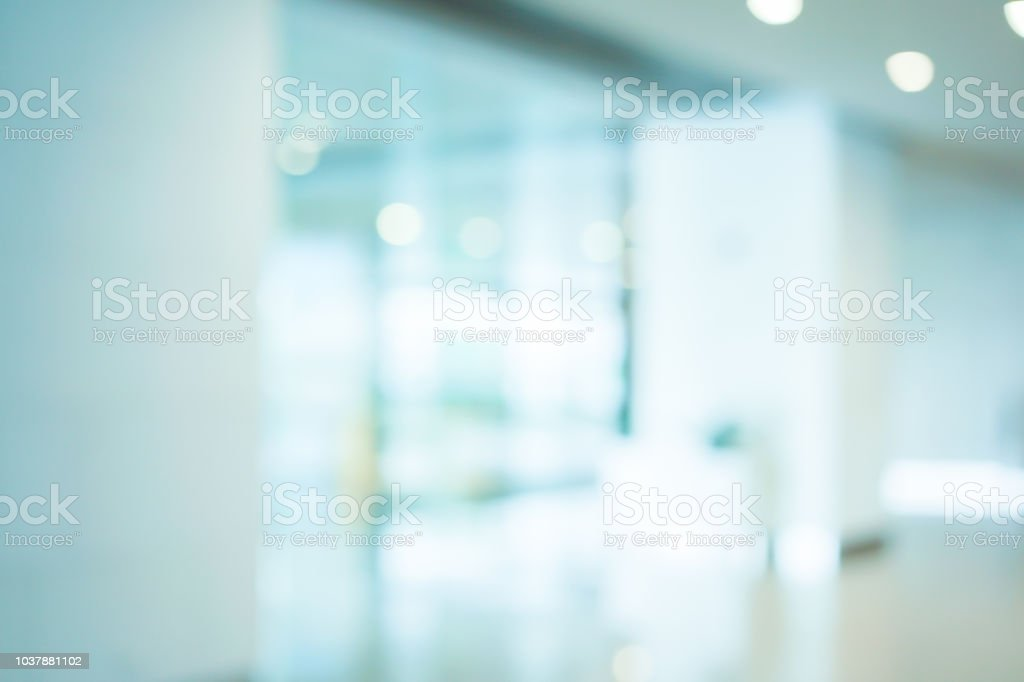 abstract blurred workplace interior with modern glass window reflective background ; loft style contemporary design of lounge or lobby for presentation and design as banner and ads stock photo