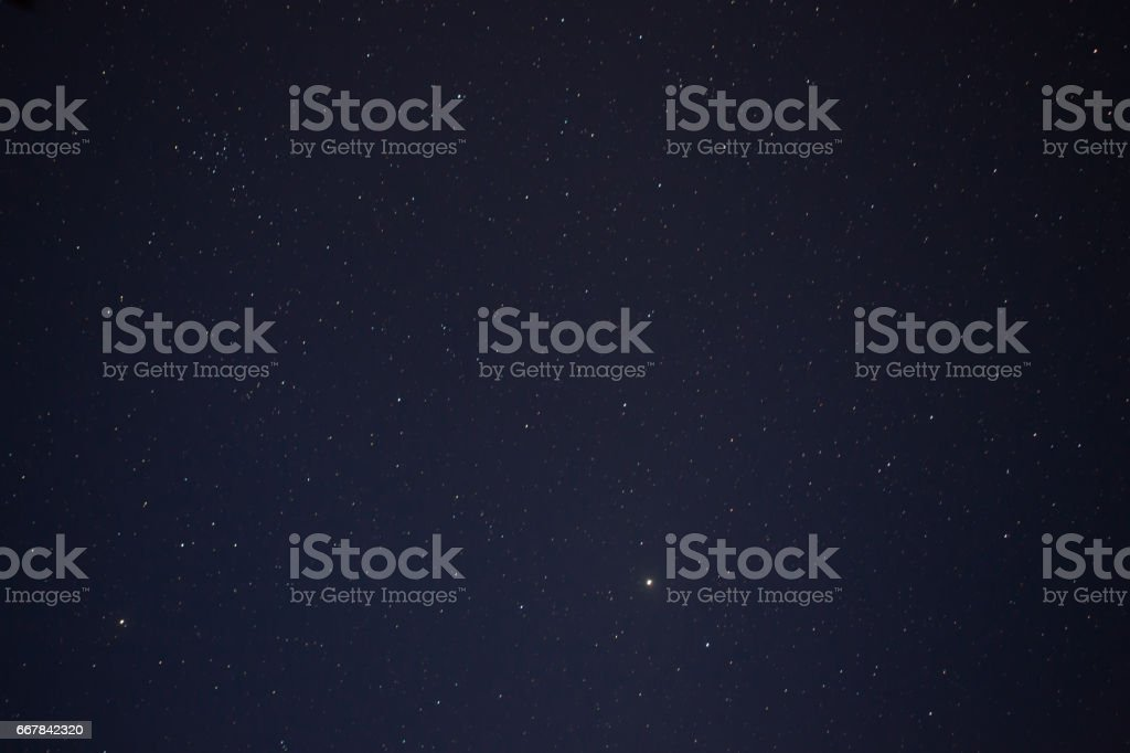 Abstract blurry background moving of stars in the sky on night time. stock photo