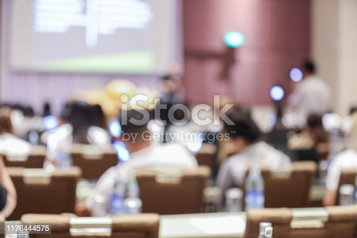 879125330 istock photo Abstract blurry background of employees seminar and De-focus teamwork staffs working meeting in conference room with projector screen. 1176444575