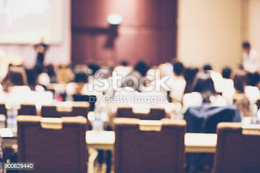 879125330 istock photo Abstract blurry background of employees seminar and De-focus teamwork staffs working meeting in conference room with projector screen. 900629440