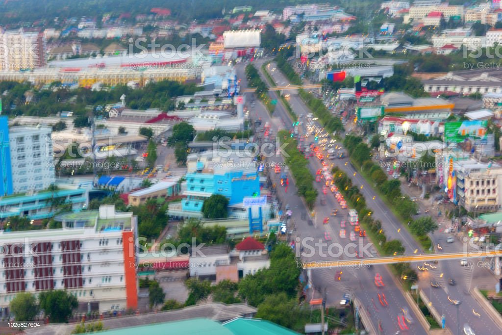 abstract blurry focus automobile congestion on road in city at rush time, bird eye view stock photo