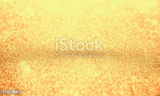 istock Abstract bokeh background. Christmas golden Glittering background. 1142165911