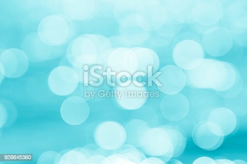 Abstract bokeh background: sunlight reflections on water surface