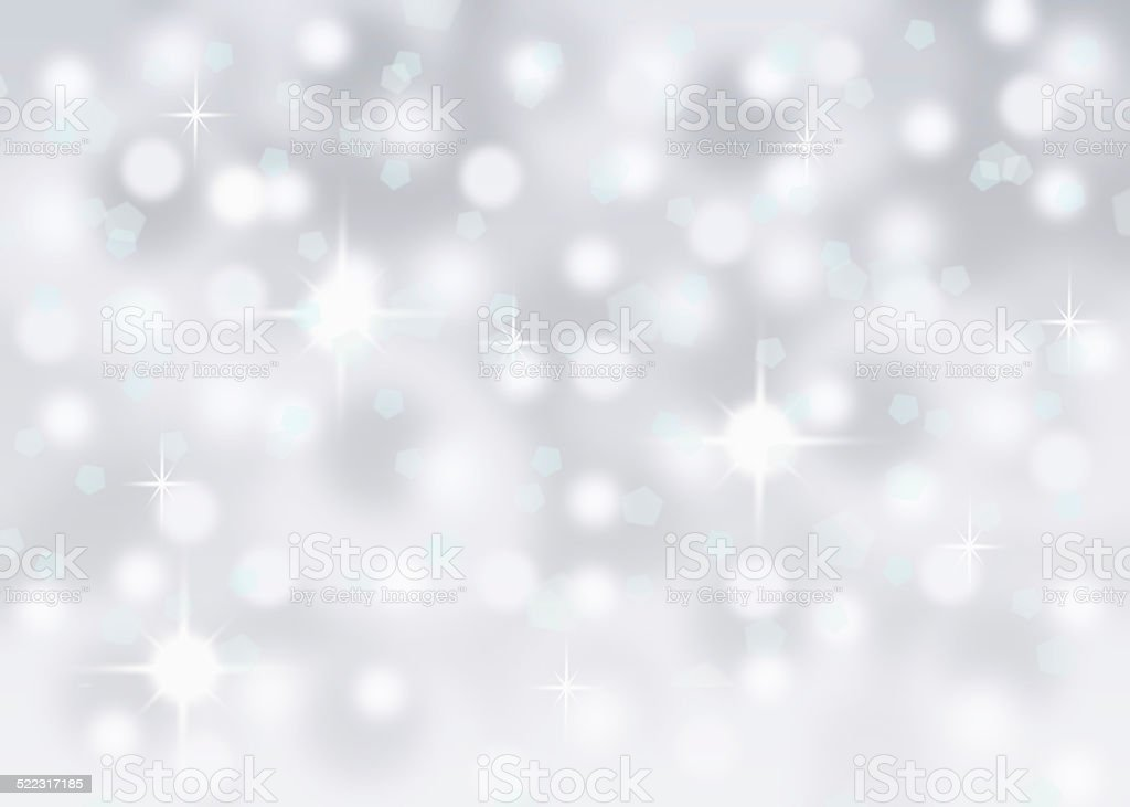 abstract bokeh cold winter snow background with sparkles stock photo