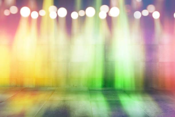 abstract bokeh multicolored neon light in dark empty scene. stock photo