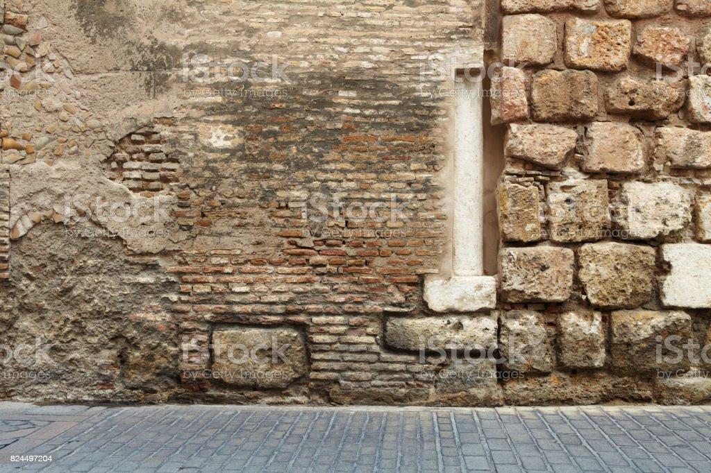 Abstract brick wall column pavers stock photo