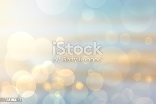 Abstract bright gradient motion spring or summer landscape texture background with natural gold yellow bokeh lights and blue bright sunny sky. Beautiful backdrop with space for design.
