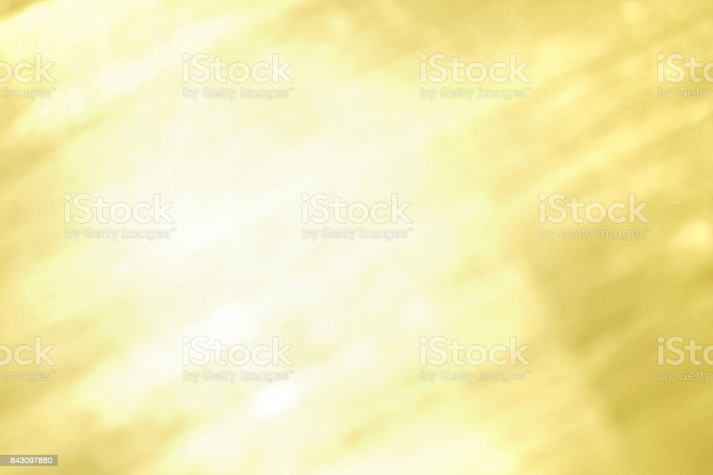 Abstract bright shiny gold blurred background. stock photo