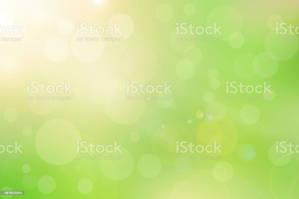Abstract bright spring background with sunlight bokeh stock photo