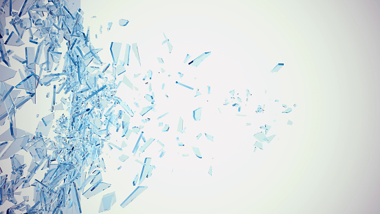 Abstract broken blue glass into pieces isolated on white background