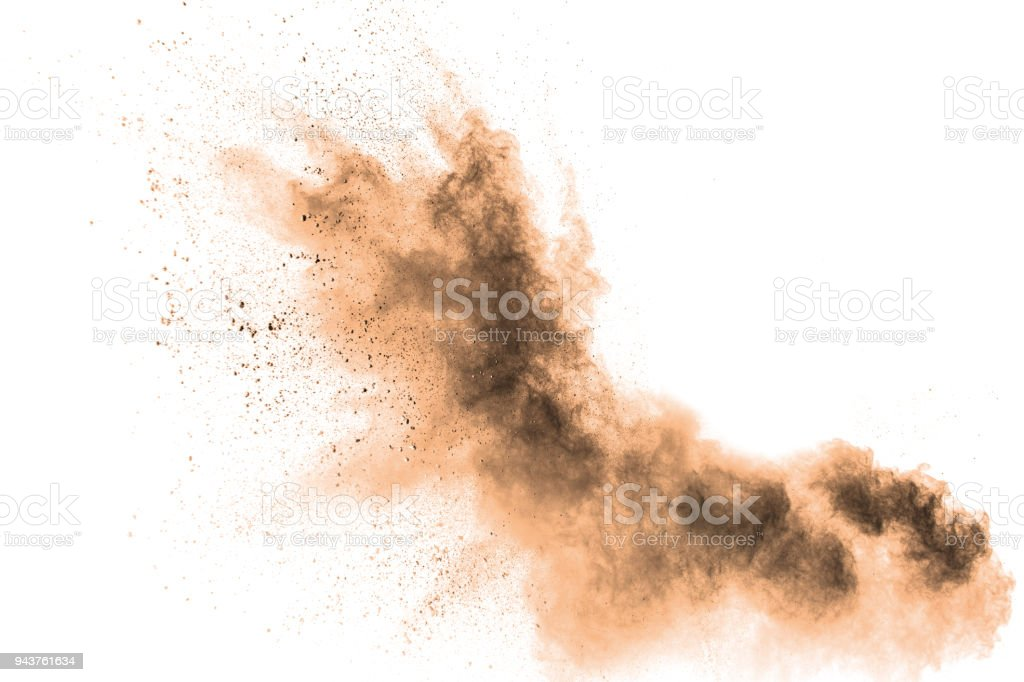 Abstract  brown colored sand splash on white background. Color dust explode on background  by throwing freeze stop motion. stock photo