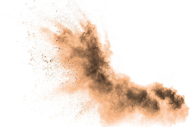 abstract  brown colored sand splash on white background. color dust explode on background  by throwing freeze stop motion. - dirty stock pictures, royalty-free photos & images