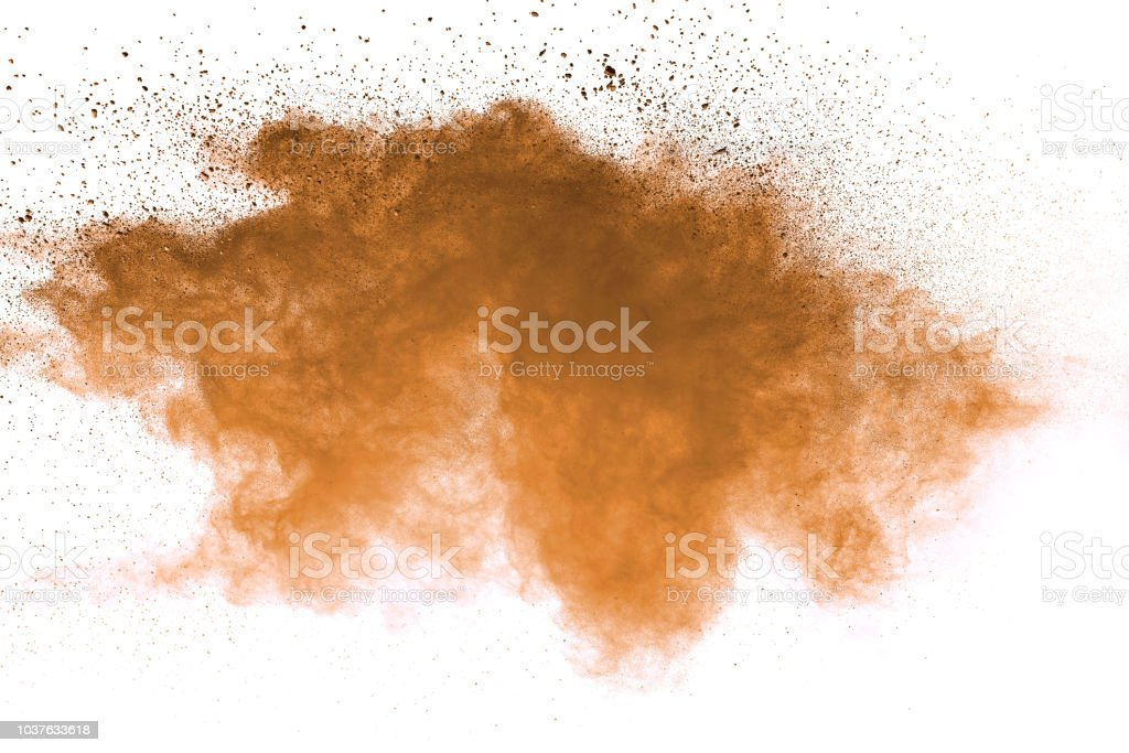 Abstract brown colored soil splash on white background. Color dust...