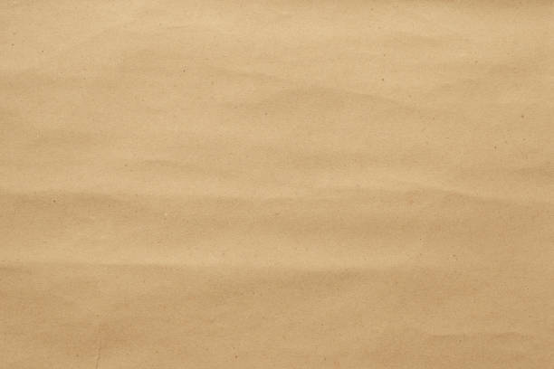 abstract brown crumpled paper texture - brown paper stock photos and pictures