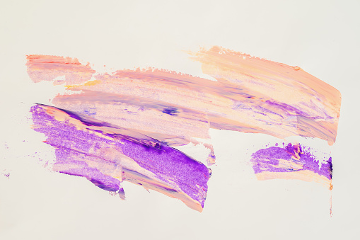 523169768 istock photo Abstract brush strokes. Close-up fragment of hand painted acrylic multicolor painting on white paper, purple and peach shades. Modern art background 855390932