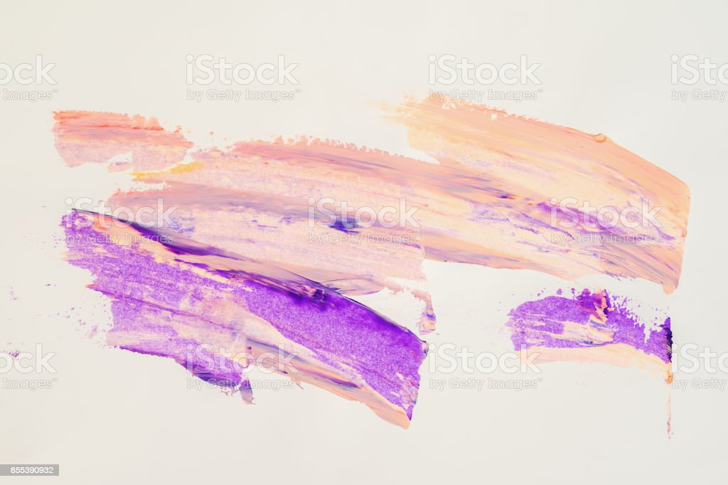 Abstract brush strokes. Close-up fragment of hand painted acrylic multicolor painting on white paper, purple and peach shades. Modern art background stock photo