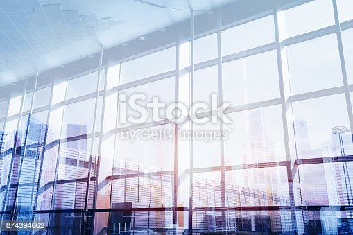 istock abstract business interior double exposure 874394662