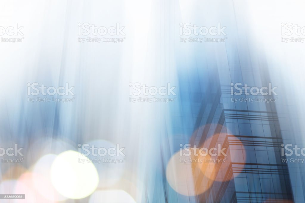 Abstract business modern city urban futuristic architecture background. Real estate concept, motion blur, reflection in glass of high rise skyscraper facade, toned blue picture with bokeh stock photo