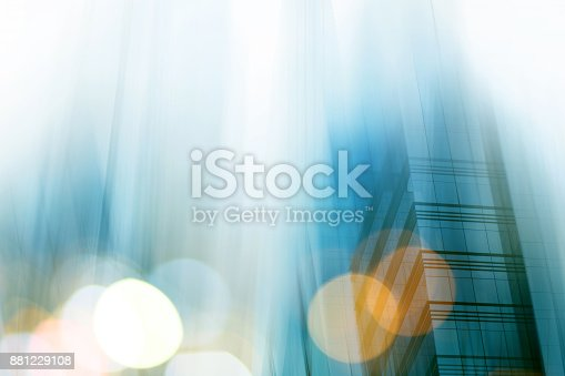 istock Abstract business modern city urban futuristic architecture background. Real estate concept, motion blur, reflection in glass of high rise skyscraper facade, toned blue picture with bokeh 881229108