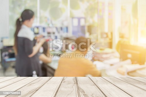 istock Abstract business people working group blurred in the workplace with work space of table work in office with computer or shallow depth of focus as corporate interior background 1090268894
