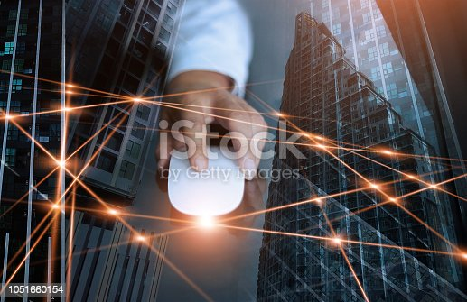istock Abstract. Businessman using mouse global network and data exchanges customer connection on city scape background. Technology business and digital networking concept. 1051660154