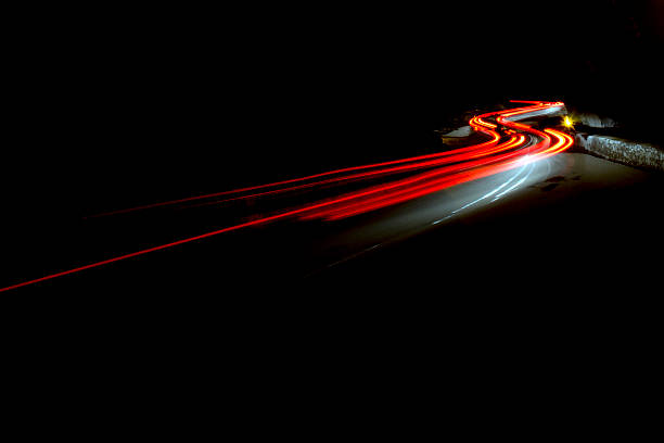 abstract car lights at night red and white Car light trails in the tunnel. Art image . Long exposure photo taken in a tunnel headlight stock pictures, royalty-free photos & images