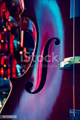 Close up of contrabass on stage, bokeh background