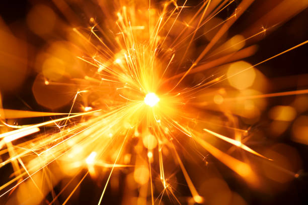 Abstract Centered Red Sparks - Sparkler Background Party New Year Celebration Technology stock photo