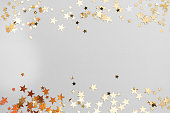 istock Abstract Christmas background with golden glitter over white board. 1185300533