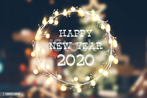 istock Abstract Christmas light background with New Year greetings 2020 1188653885