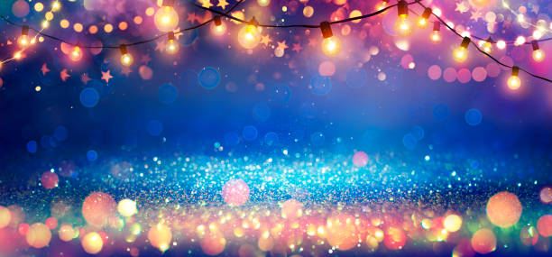 Abstract Christmas Party Background - Golden Glitter With Defocused Effect In Shiny Night And Bulb-lights stock photo