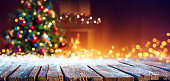istock Abstract Christmas - Snowy Table With Bokeh Lights And Defocused Christmas Tree 1282019923