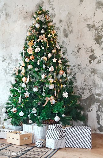 1136239089 istock photo Abstract Christmas tree background with golden and white decoration 1055158280