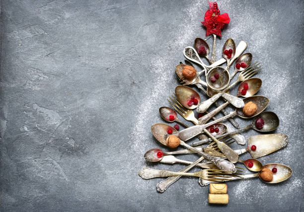 abstract christmas tree made from cutlery - vintage ornaments stock photos and pictures