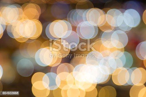 istock Abstract circular bokeh background of night light 654933668