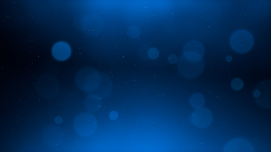Abstract blue circular particles bokeh background
